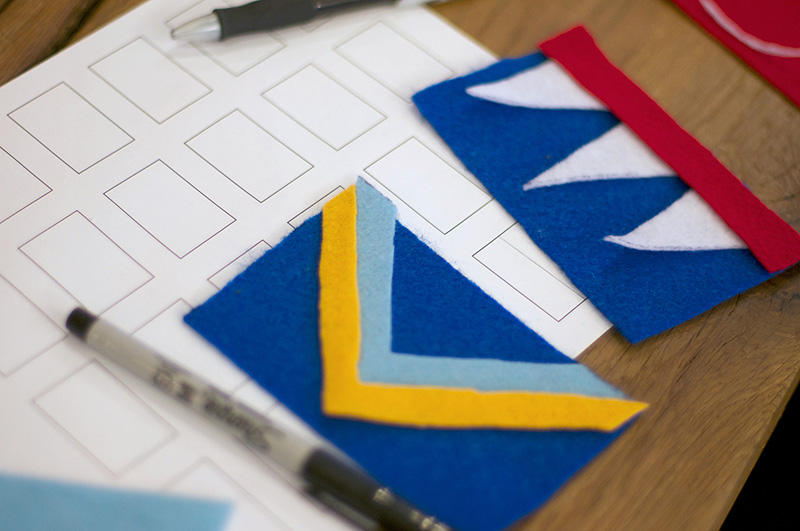 Two felt flag designs and sketching materials